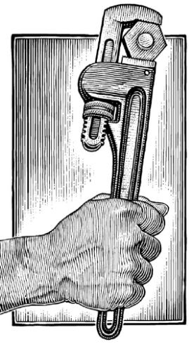 A Workers hand grasping a wrench
